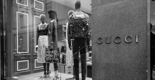 Milan Italy - October 9 2016: Shop window and entrance of a Gucci shop in Milan - Montenapoleone street Italy. Few days after Milan Fashion Week. Fall Winter 2017 Collection.